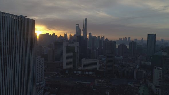Thumbnail for Shanghai Skyline at Sunny Sunrise. Aerial View. China. Drone Is Flying Forward and Upward