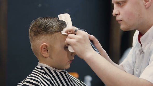 Thumbnail for Hairdresser Making Hair Cut for Little Boy. Machine. Barber Cutting Hair with Hair Trimmer