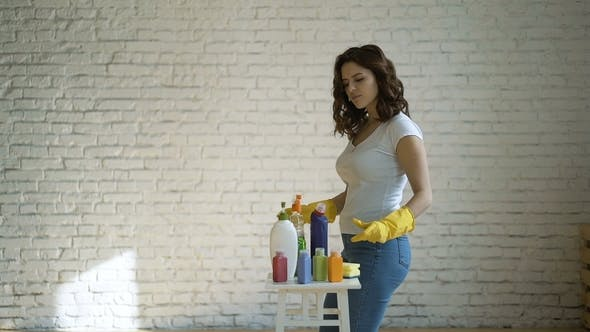 Woman Comparing Spray Detergent Products