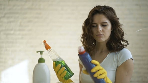 Thumbnail for Beautiful Young Girl Cleaning Up Her House