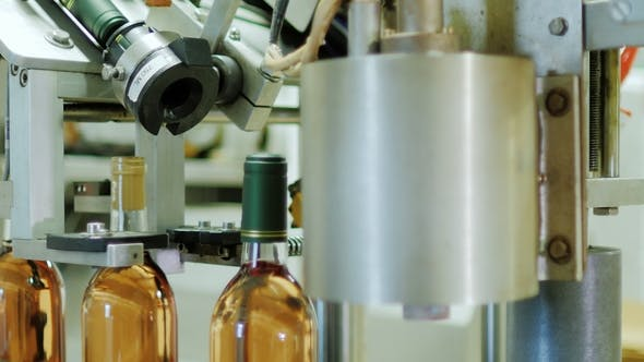 Thumbnail for Full Automated Conveyor Line in the Winery. Closes Bottle Full of Wine