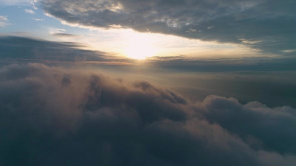 Thumbnail for Flying Forward over Heavy Grey Dark Clouds at Sunrise