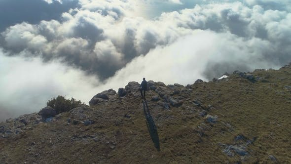Thumbnail for Man Is Standing on the Edge of Mountain