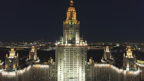 Thumbnail for Moscow State University Main Campus and Illuminated Moscow Cityscape at Night. Russia. Aerial View
