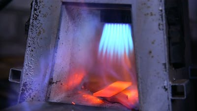 the Knife Is Heated in a Gas Oven By a Blacksmith. Forging Knife