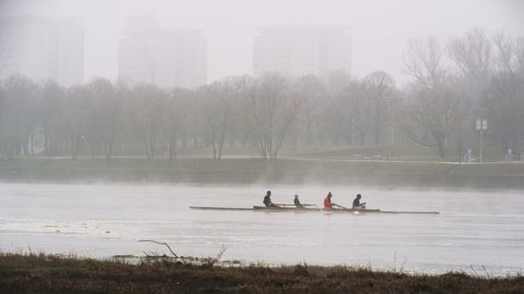 Thumbnail for Three Men Sculling Backwards in Urban Area