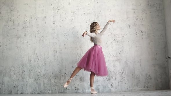Thumbnail for a Ballet Dancer in Pointe Shoes and a Classic Tutu Gracefully Raises Her Leg.