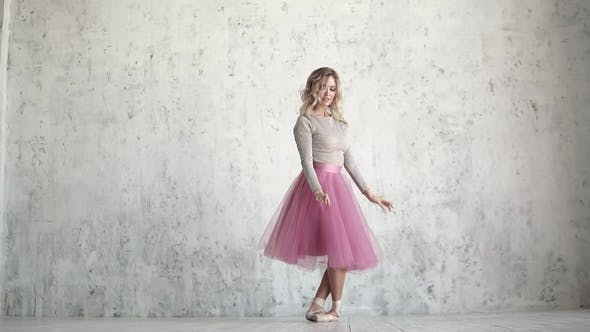 Thumbnail for A Young Ballerina in a Pink Classic Pack and Pointe Shoes Gracefully Dances. Beauty and Grace of