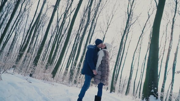 Thumbnail for Couple Walking through the Winter Forest
