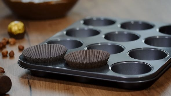 Thumbnail for Baking Cupcake, Putting Cupcake Wrappers in Baking Tray