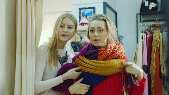 Thumbnail for Two Friends Try on Things in a Clothing Store. Look in the Mirror