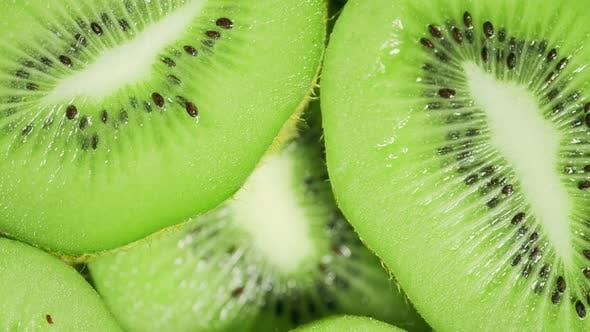 Slow Motion of Rotation Ripe Green Sliced Kiwi