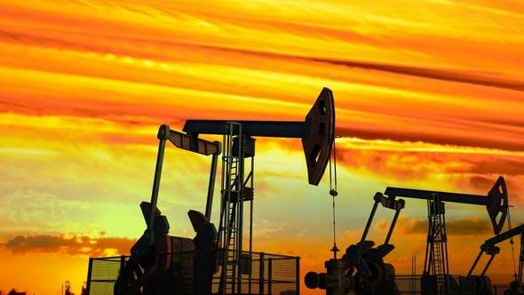 Cover Image for Move Along Oil Pump Jacks Against Dusk