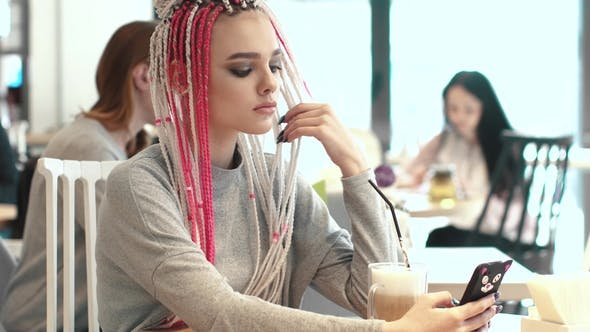 Thumbnail for Portrait of a Girl with Dreadlocks in a Cafe. a Teenager with an Unusual Appearance. Subculture of