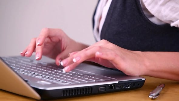 Thumbnail for Woman Working at Home on Laptop Computer
