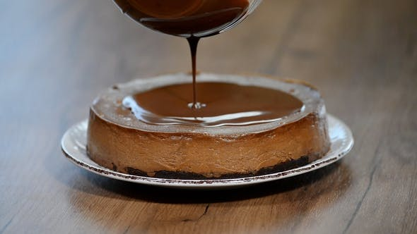 Thumbnail for Pouring Chocolate Ganache on a Chocolate Cheesecake