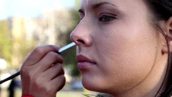 Thumbnail for Professional Make Up Artist Working on a Model