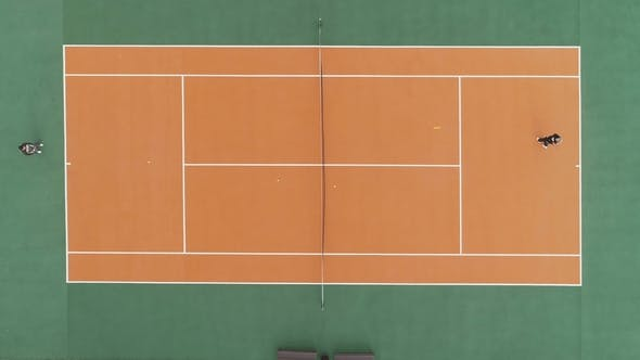 Thumbnail for Players Are Playing Tennis on Green and Orange Court. Aerial Vertical Top Shot. Drone Is Hovering