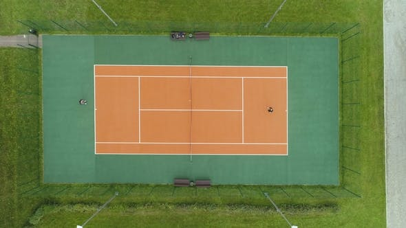 Thumbnail for People Are Playing Tennis on Court. Aerial Vertical Top View. Drone Is Flying Downward
