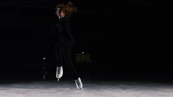 Cover Image for Skater in a Black Suit with a Beautiful Contour Light Accelerates and Stops Abruptly