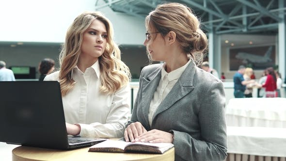 Thumbnail for Business Women Working Together on a Laptop. Girl in a Business Suit and Her Boss