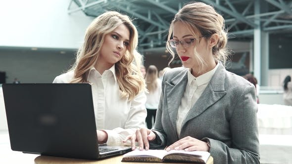 Thumbnail for Girl Manager at a Meeting with the Client. Two Business Women Talking at a Conference