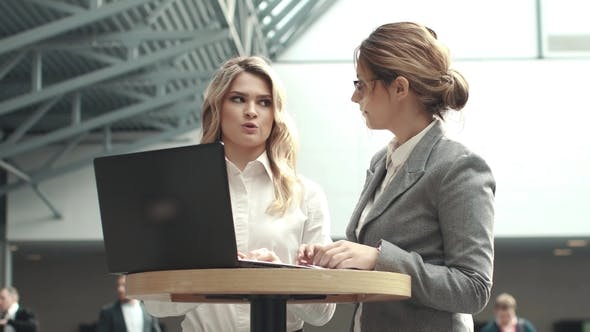 Thumbnail for Business Meeting of Two Confident Women. Girl Typing Text on Laptop