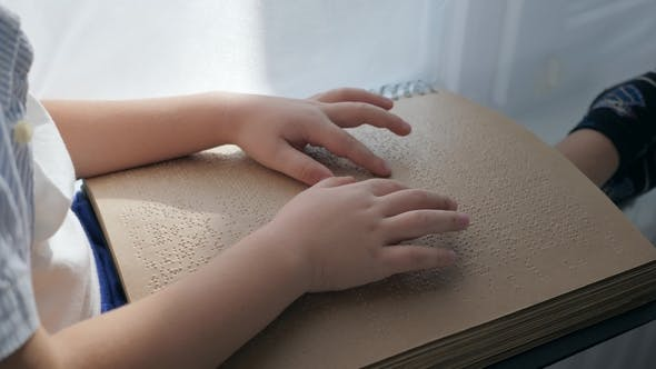 Thumbnail for Visually Impaired Man Reading Braille Book