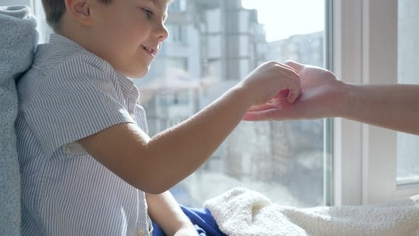 Thumbnail for Treatment of Child Who Takes Pill and Drinks Mineral Water from Transparent Glass