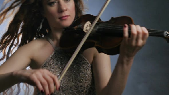 Thumbnail for Violin in Arms of Musical Artist at Symphony Orchestra