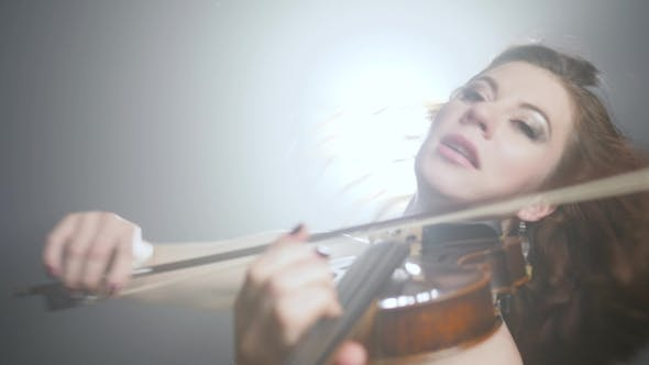 Thumbnail for Talented Violinist with Long Hair Performs Classical Music at Symphony Concert