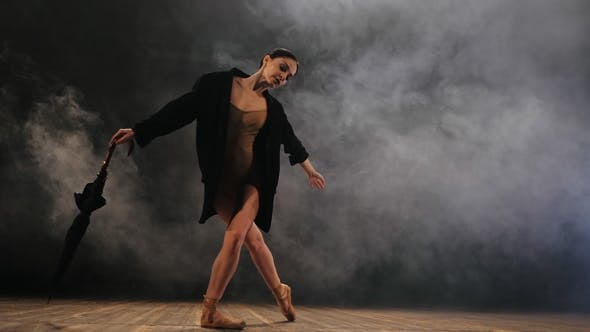 Thumbnail for Ballerina in Black Long Jacket on Sexy Bodysuit Dancing on Stage with Magic Light and Smoke