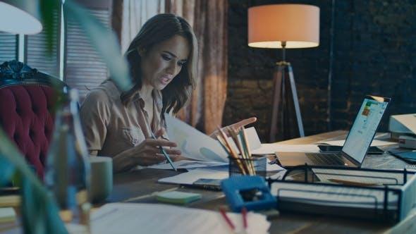 Thumbnail for Serious Businesswoman Doing Business Data Analysis