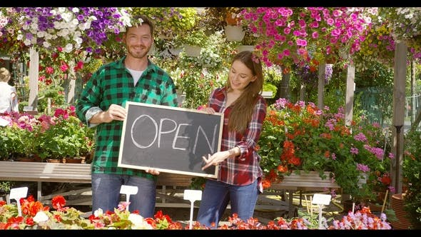 Thumbnail for Cheerful Couple in Outside Flower Shop