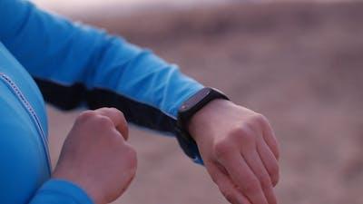 Smart Watch Woman Using Smartwatch Touching Button Outdoors