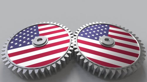 American National Project Flags of the United States on Moving Cogwheels