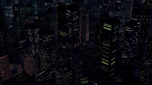 Helicopter Flyover of a Downtown City at Night