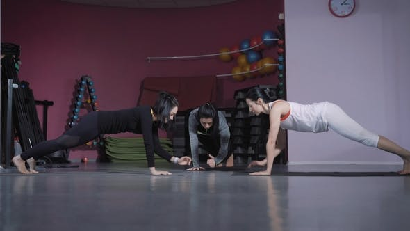 Thumbnail for Three Spotswomen Are Doing Different Exercises for Abs in a Fitness Studio