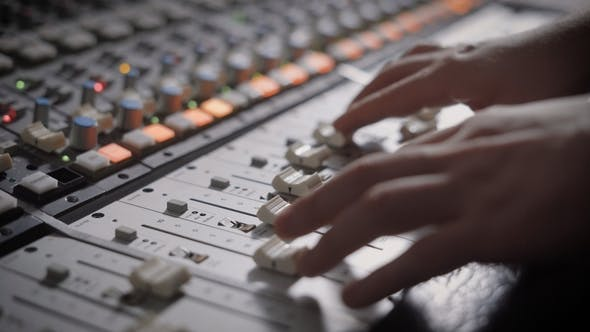 Thumbnail for Shot of Professional Dj's Hands Working with a Recording Board in Studio