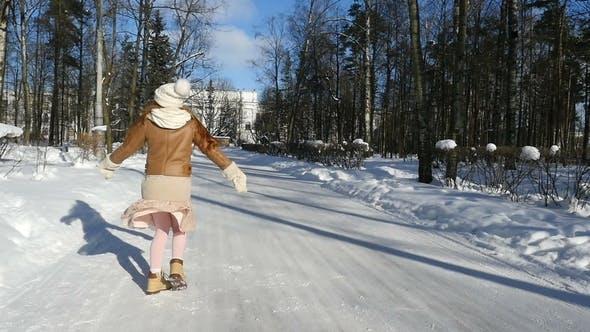 Thumbnail for Happy Teen Girl Spinning on Winter Park