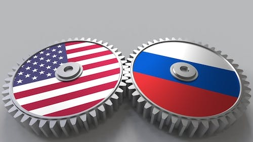 Flags of the USA and Russia on Meshing Gears