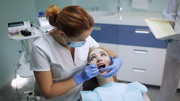 Thumbnail for Female Stomatologist in Mask