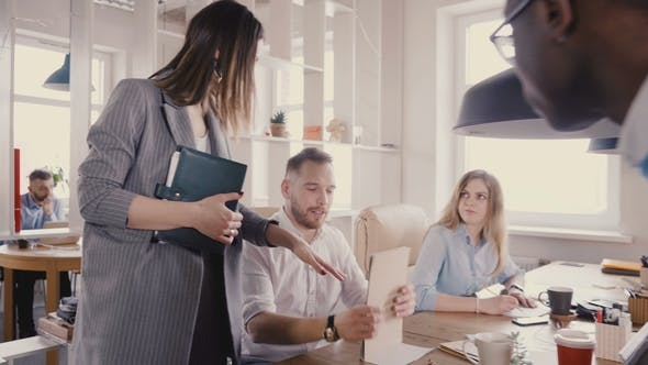 Thumbnail for Camera Follows Female CEO Motivating Workers. Woman Boss Chats with Colleagues, Gives Them