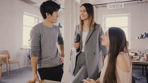 Thumbnail for Camera Follows Female Leader Enter Office, Then Chat with Colleagues. Happy Multiethnic Business