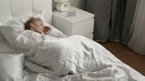 Girl Is Sleeping on the Bed