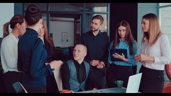 Director and His Team Discuss the Company in the Office