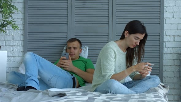 Thumbnail for Couple Addicted To Smartphones and Games Online