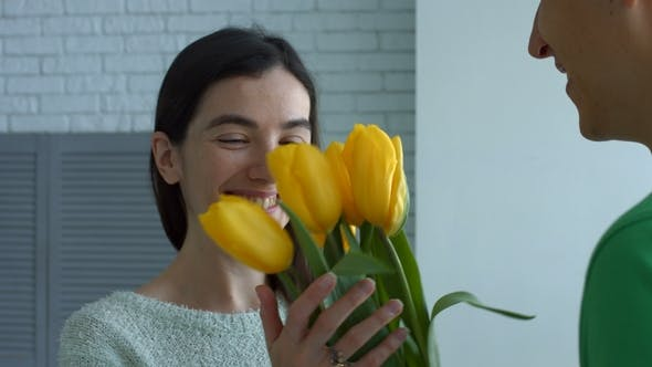 Thumbnail for Lovely Woman Enjoying Smell of Flowers Given By Man