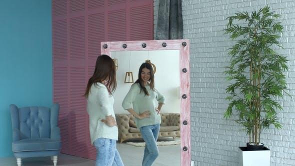Thumbnail for Joyful Woman Checking Her Body Shape in Mirror