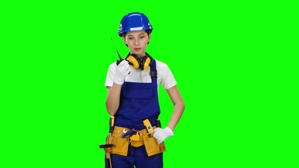 Thumbnail for Bilder Girl Wearing Wearing Talks on the Walkie Talkie